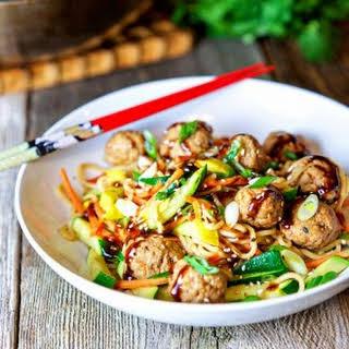 Poached Pork Meatballs with Vegetable Noodle Stir Fry.