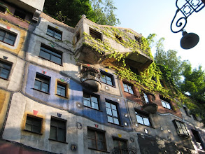 Photo: Hunderwasse Village, a collection of very organic building incorporating a lot of trees and plants.