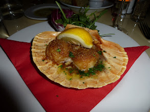 Photo: Scallops on a shell dish