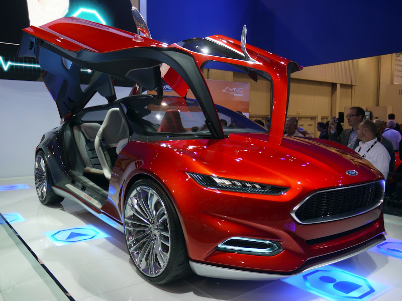 "Photo: Lots of concept cars at CES. They emphasize alternative energy and the confluence of cars and emerging technology. They also all come equipped with gull-wing doors. It must be a prerequisite to be considered a ""real"" concept car. This one is cool. It is the Ford Evos Concept. They are pushing seamless connectivity between the vehicle and what they call the driver's 'personal cloud'. I don't know who came up with that line, but it is ripe for jokes."