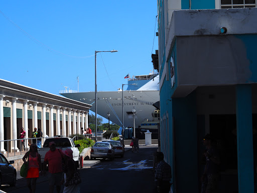 Down a side street on Nassau, Enchantment of the Seas can be seen