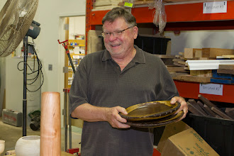 Photo: Richard Webster brought in 2 of the 6 natural-edged chargers he made, to match a rustic house, ...