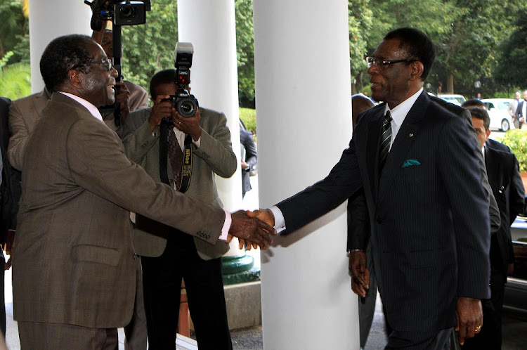 FILE PICTURE: Former Zimbabwean President Robert Mugabe (L) welcomes Equatorial Guinea President Teodoro Obiang Nguema Mbasogo in Harare.