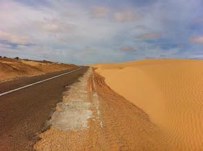 Photo: Sand dunes by the road Tarfaya