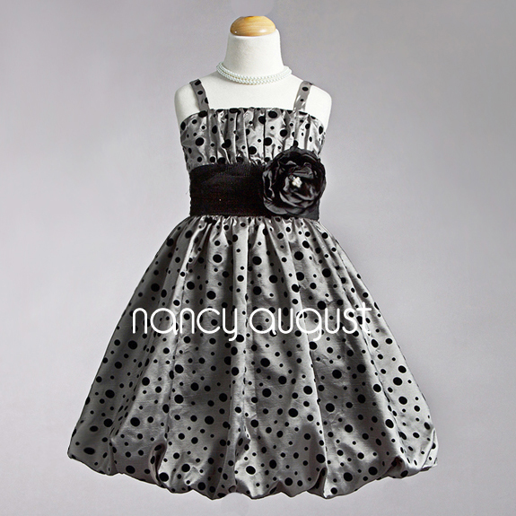 Photo: The Perfect #Polkadot #Silver Holiday #Dress: Looking for the perfect holiday dress for your holiday photos? This adorable silver holiday dress is the one if you're looking for something sweet and simple to please the crowd. This dress is made of a light weight poly blend fabric with the cutest little velor polkadots. Best of all it won't weigh your little girl down when she's having fun at this years holiday festivities.