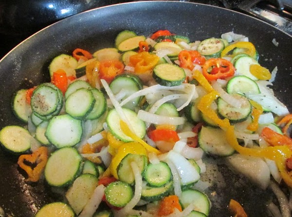 Then add sliced veggies to skillet when butter has melted and oil is hot.