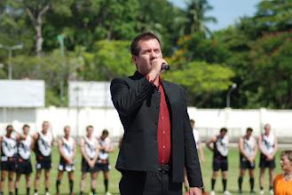 Photo: Australian National Anthem is sung by Paul Greene. Photo, Richard Quinn.