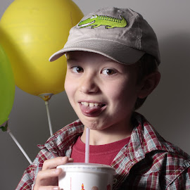 by Jennifer Storch - Babies & Children Child Portraits ( baloon, tongue, coke, drink, dummy, teeth, hat )