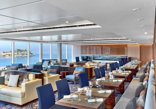 Viking-Ocean-Ship-Explorers-Lounge.jpg - Share a cocktail, linger over a Norwegian breakfast or check out a nautical history book at the Explorers Lounge on Viking ocean cruises.