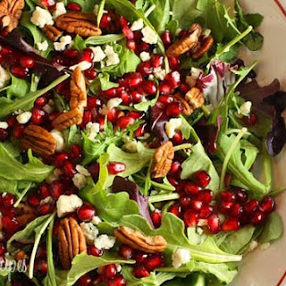 Mixed Baby Greens with Pomegranate Seeds, Gorgonzola and Pecans.