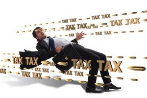 Man in a suit avoiding bullets from taxes