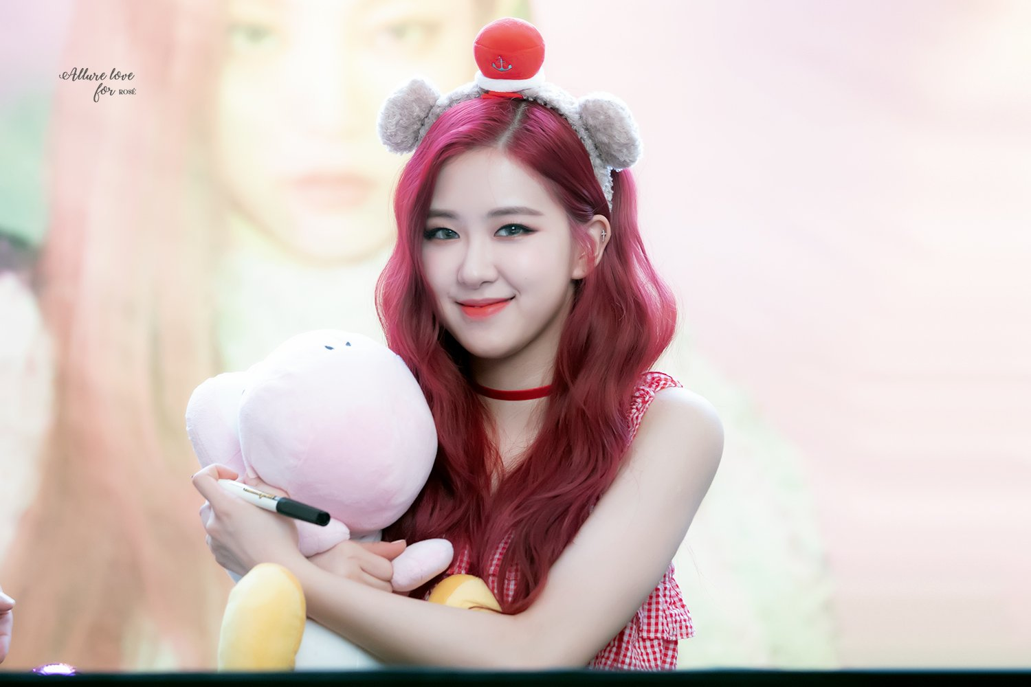 Rosé holding stuffed animal