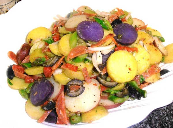 Add potatoes to veggies and toss well.  Put in a large salad bowl...