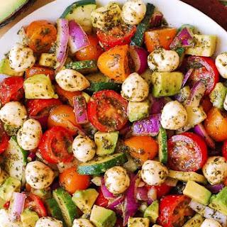 Avocado Salad with Tomatoes, Mozzarella, Basil Pesto.