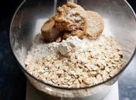 In a large bowl, combine flour, brown sugar, oats, white sugar, butter, cinnamon, and...