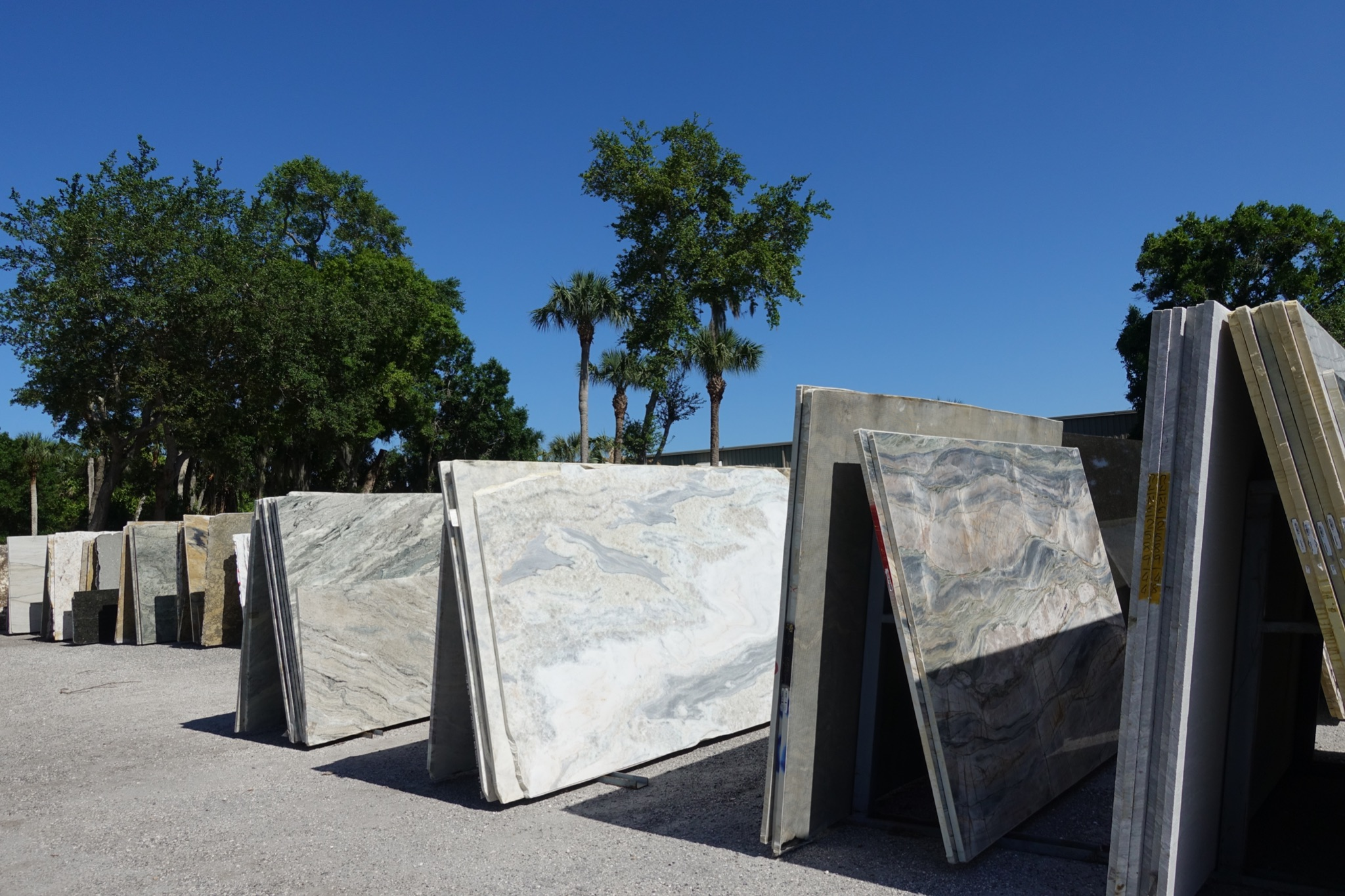 Slabs of granite at a stone supplier. Granite is a type of felsic intrusive igneous rock that is granular and phaneritic in texture. Granites can be mostly white, pink, or gray in color.