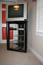 "Photo: $755-shelf TV stand w/ glass shelves + $2532"" Tube TV"