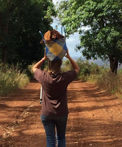Me carrying a basket on my head to help out the malagasy women in madagascar
