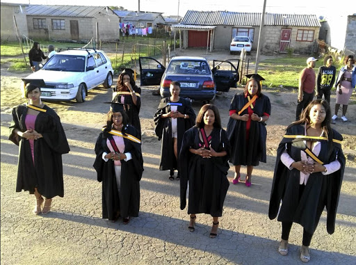 Puleng Serame wears her blue sash, along with six other graduates from Thabong in Welkom. Their photos have inspired many.