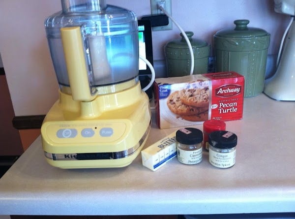 Pulse cookies or graham crackers (I've had great results using ginger snaps also) in...