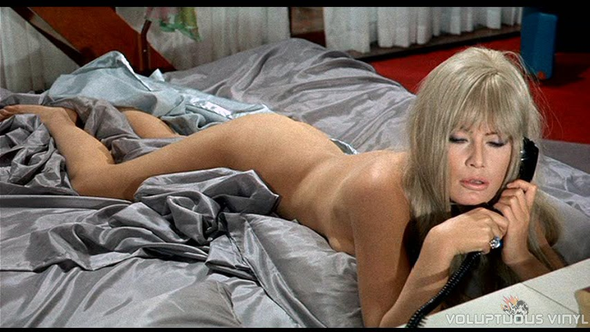 Marisa Mell nude in bed.