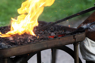 Photo: Blacksmith heating a blade for quenching