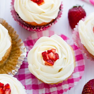 Strawberry Filled Vanilla Cupcakes.