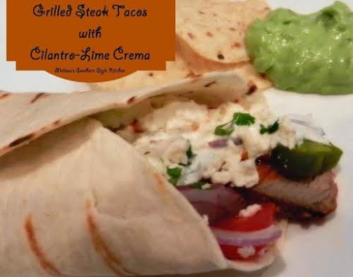 "Grilled Steak Tacos With Cilantro Lime Crema ""Enjoy succulent, tender, steak strips..."