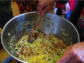 Photo: tossing noodles with garlic oil