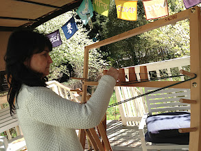 Photo: student learning to wind her first warp