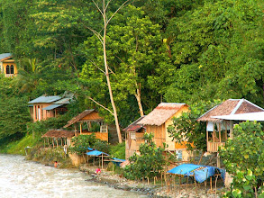 Photo: Bukit Lawang - huts by the river