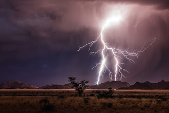 Photo: An electrical storm near Sesriem, Namibia, just after sunset.