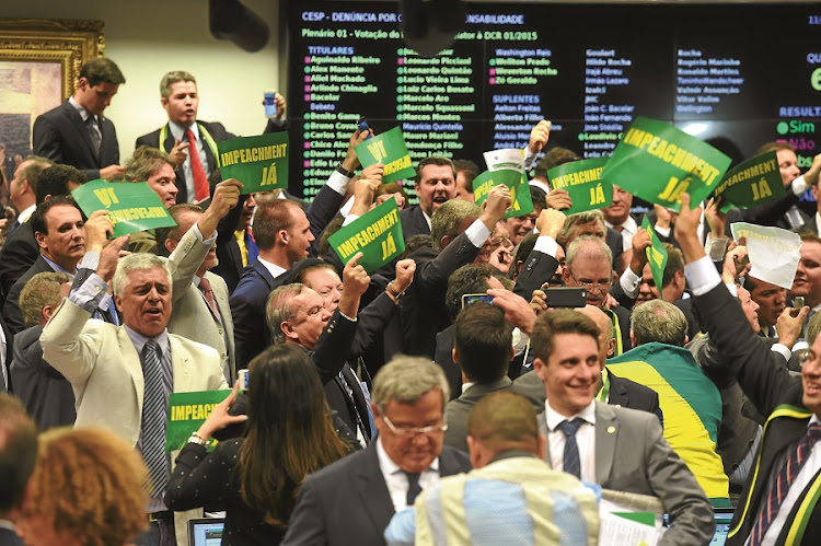 ON HER WAY: A Brazilian congressional committee celebrates after a vote to recommend that President Dilma Rousseff be impeached, in advance of a vote in the lower house to decide whether she should face trial. Rousseff is accused of fiddling with accounts to mask the dire state of the government budget during her 2014 re-election. Picture: GALLO IMAGES/AFP/EVARISTO SA