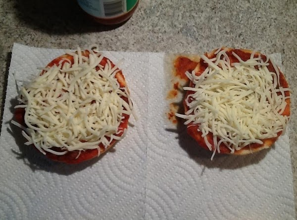 Sprinkle 1/4 cup of mozzarella cheese to each bagel half