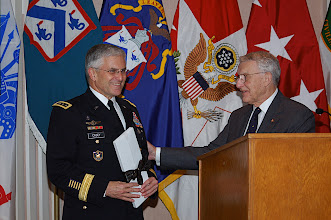 Photo: Lt. Gen. (Ret.) Robert Arter, Chairman of the CGSC Foundation, presents Chief of Staff of the Army Gen. George W. Casey with a small gift after his remarks at the National Security Roundtable Dinner March 16, at Fort Leavenworth's Frontier Conference Center.