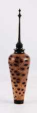 "Photo: Don Van Ryk - 2"" x 9"" vase with finial [banksia pod and ebony]"