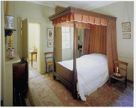 Photo: A British mid Victorian bedroom, upper middle class. Note the chair being used as a night table. The night table hadn't come into use and it was common practice to set the candle on a handy chair when getting into bed.