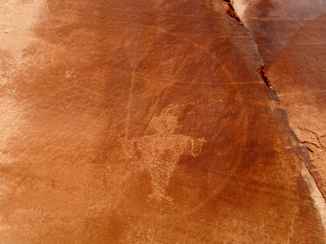 Fremont style petroglyph with broom and semi-circle