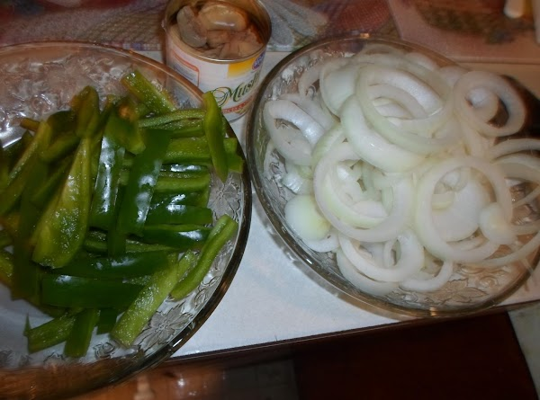 Meanwhile, with sausage cooking, prepare the bell peppers and onions.