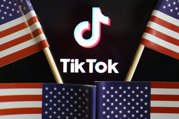 US flags are seen near a TikTok logo. Picture: REUTERS/FLORENCE LO