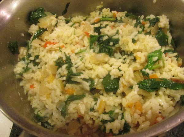 After spinach has wilted, add the cooked rice and shredded parmesan cheese, and stir...
