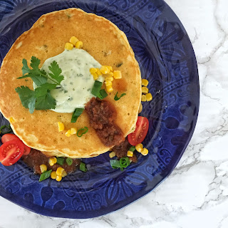 TexFest Inspired Jalapeño Johnnycakes with Avocado & Cilantro Cream Sauce.