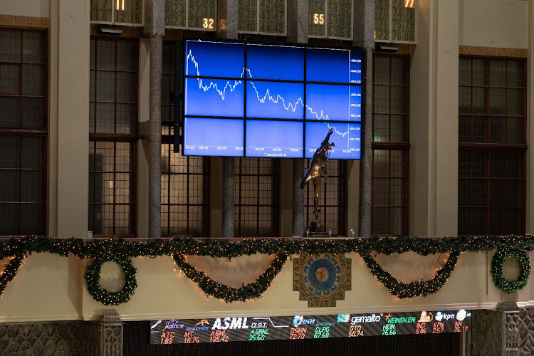 The AEX Index curve is displayed on a screen inside the Amsterdam Stock Exchange in Amsterdam, the Netherlands, on January 7 2019. Picture: JASPER JUINEN/BLOOMBERG