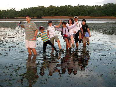 Dr Yaacob Ibrahim, Minister for the Environment and Water Resources, Singapore, with family and friends crossing the seagrass lagoon