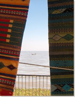 boat on Lake Chapala, seen through Oaxacan rugs