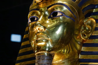 Photo: The gold mask of King Tutankhamun is seen in its glass case during a press tour, in the Egyptian Museum near Tahrir Square, Cairo, Egypt, Saturday, Jan. 24, 2015. German restoration specialist, Christian Eckmann, summoned to Cairo to examine the damaged burial mask, spoke at a packed news conference Saturday at the Egyptian museum, saying that epoxy used to glue the mask's beard back on can be removed and the mask properly restored. Eckmann said the beard, which has been detached before from the mask and had likely loosened over the years, was accidentally knocked off last August during work on the relic's lighting. (AP Photo/Hassan Ammar)