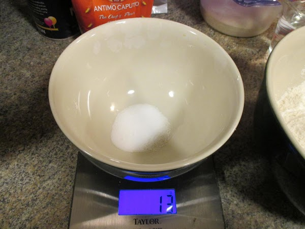 Similarly measure the yeast and salt, transferring each to the large bowl.