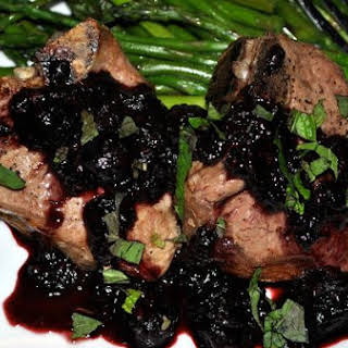 Grilled Lamb Chops and Asparagus With Balsamic Berry Sauce.