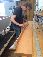 Photo: Jim using his Shaw & Tenney paddle to check prepared wood patterns.