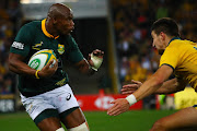 Australia's Jack Maddocks (L) tackles South Africa's Makazole Mapimpi (R) during the 2018 Rugby Championship game between Australia and South Africa at Suncorp Stadium in Brisbane, Australia on 8 September 2018.